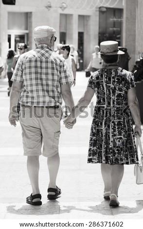 Happy loving senior couple enjoying vacation together - stock photo
