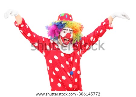 Happy male clown dancing isolated on white background - stock photo