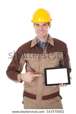 Happy Male Construction Worker Holding Digital Tablet On White Background - stock photo