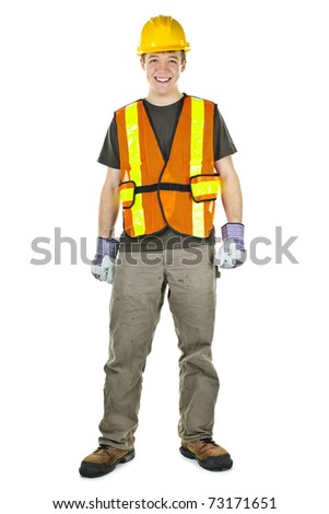Happy male construction worker standing in safety vest and hard hat - stock photo