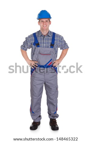 Happy male construction worker standing on white background - stock photo