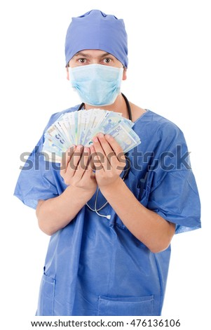 Happy male doctor holding bank notes, isolated