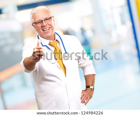 Happy Male Doctor With Thumbs Up, Indoor - stock photo