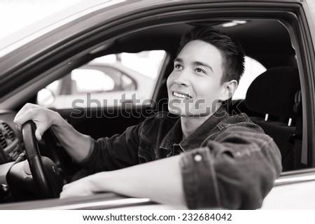 Happy male driver - stock photo