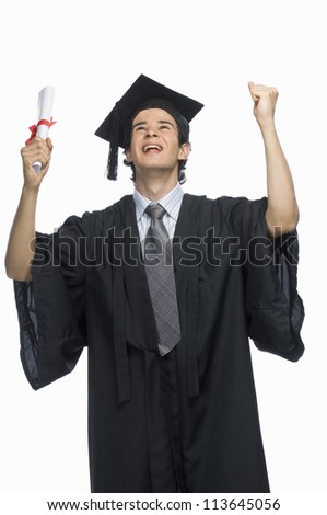 Happy male graduate holding his diploma