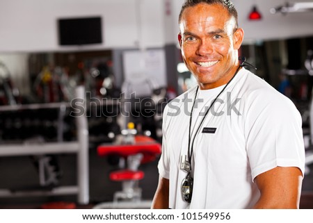 happy male gym instructor portrait - stock photo