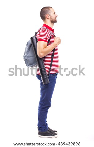 Happy male student on white background - stock photo