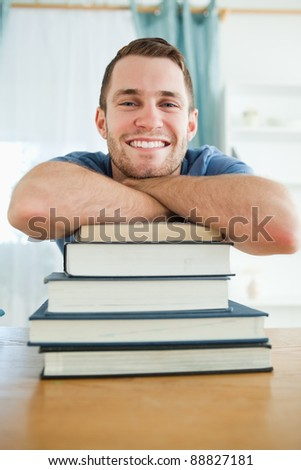 Happy male student with his books - stock photo