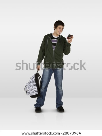 Happy male teen text messaging - stock photo