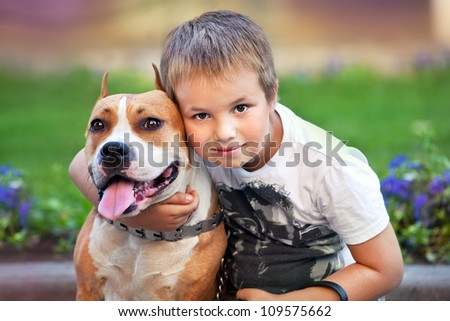 Happy man and his dog in summer street - stock photo