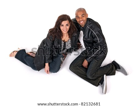 Happy man and woman sitting close to each other and smiling. - stock photo