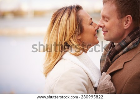 Happy man and woman standing face to face - stock photo