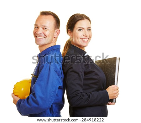 Happy man as worker and woman as business professional leaning back to back - stock photo