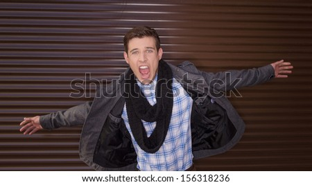 Happy man. Cheerful young men with open mouth holding hands outstretched - stock photo