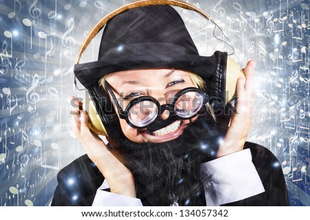 Happy man dancing to nightclub music with large earphones in a depiction of a silent disco party event - stock photo