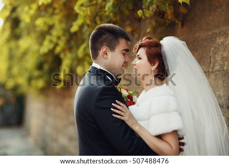 happy man embracing his beloved wife