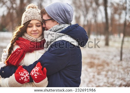 Happy man embracing his girlfriend outdoors  - stock photo
