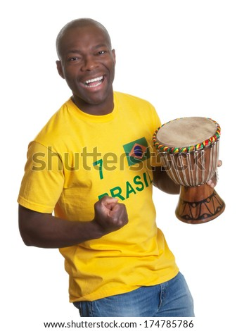 Happy man from brazil with drum - stock photo
