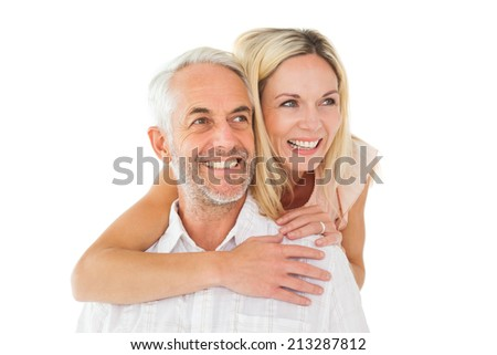 Happy man giving his partner a piggy back on white background