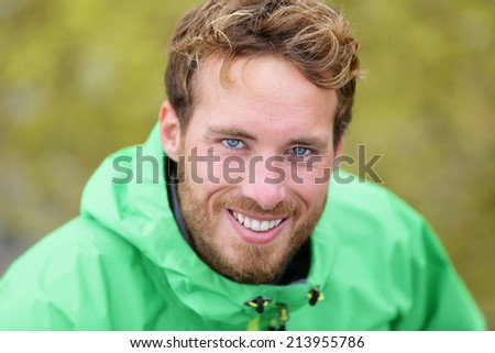 Happy man hiking portrait in nature outdoors. Handsome caucasian male smiling. - stock photo