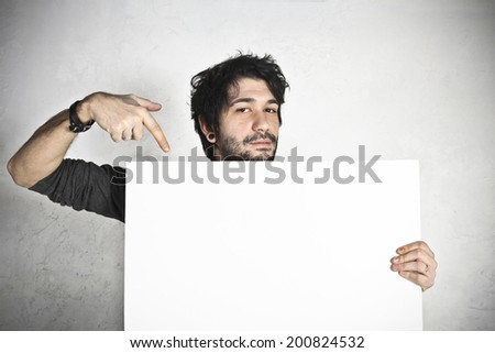 Happy man holding an empty white board  - stock photo