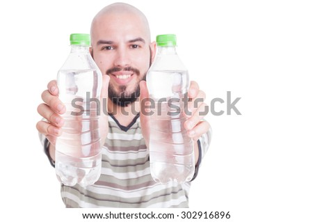 Happy man holding two plastic bottles of water as hydration or dehydration in summer heat concept