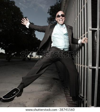 Happy man in a tuxedo - stock photo