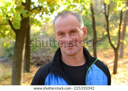 Happy man in autumn park - stock photo