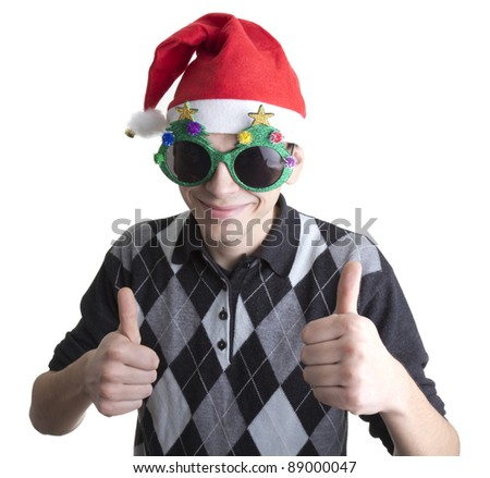 Happy man in Christmas party glasses and hat shows thumbs up