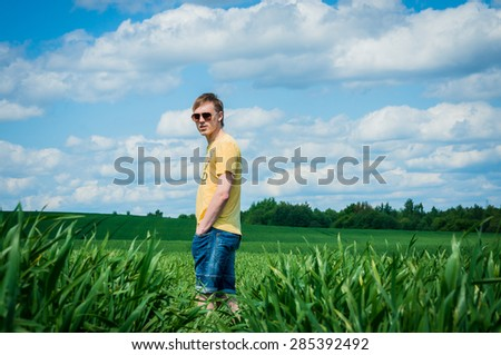 happy man in the green field - stock photo