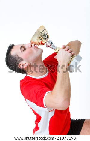 Happy man kissing cup. Side view. - stock photo