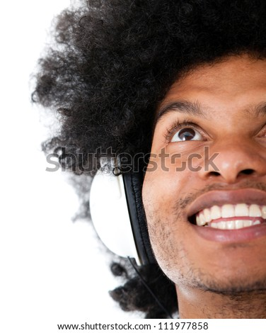 Happy man listening to music with headphones - isolated over a white background
