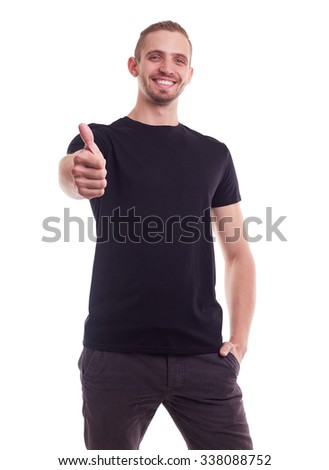 Happy man makes a gesture thumb up, portrait on white background - stock photo