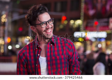 Happy man on Times Square, New York, at night - stock photo