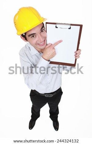 Happy man pointing at clip board