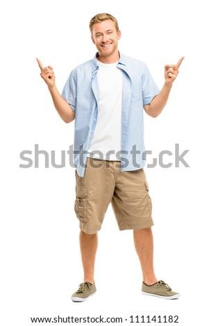 Happy man pointing - portrait on white background - stock photo