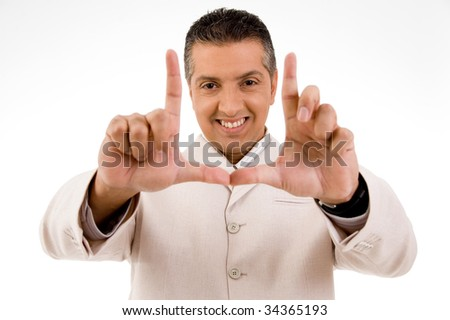 Happy man posing in front of camera - stock photo
