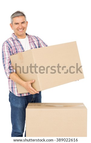 Happy man posing with moving boxes on white background