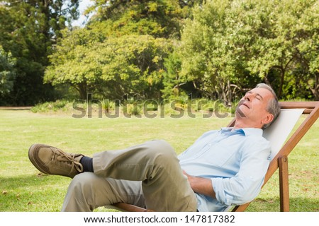 Happy man relaxing in park - stock photo