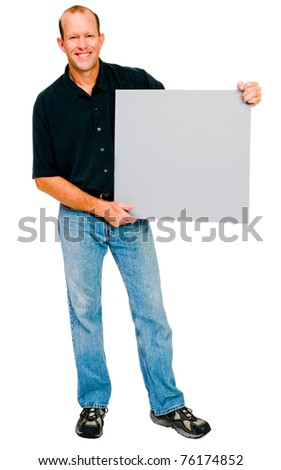 Happy man showing a placard isolated over white - stock photo