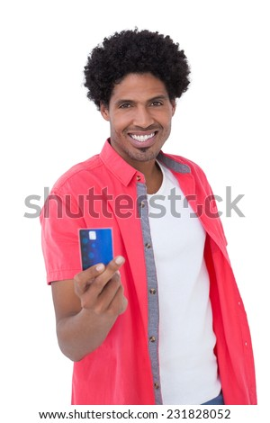 Happy man showing credit card on white background