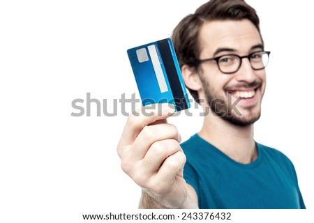 Happy man showing his new credit card - stock photo