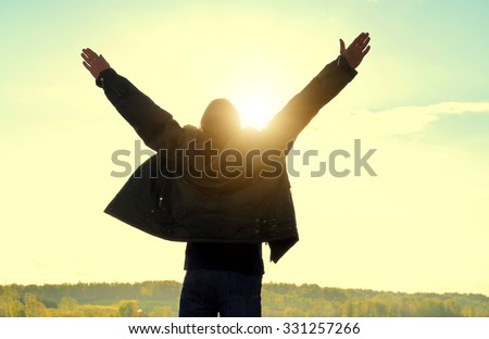 Happy Man Silhouette with Hands Up on the Nature Background - stock photo