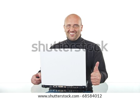Happy man sitting at office desk and showing thumbs up sign