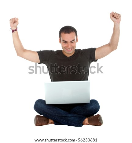 Happy man sitting on the floor with a laptop - isolated over a white background - stock photo