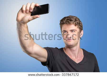 happy man taking selfie by smart phone - stock photo
