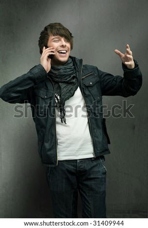 Happy man talking over cellphone - stock photo