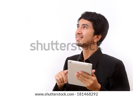 Happy man using digital tablet - stock photo