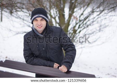 Happy man wearing winter clothes on a cold day