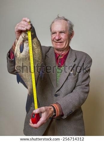 Happy man with big fish. - stock photo